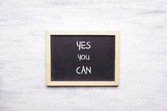 Top view of chalkboard with YES, YOU CAN written on it Stock Photos