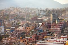 Top view on many colored houses in Kathmandu. Top view on chaos of colored buildings in Kathmandu - the heap of houses in the Asian cities caused by big Stock Images