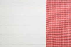 Top view of checkered cloth napkin on white wooden table. Top view of red checkered napkin or tablecloth on white wooden table with visible planks, texture and Stock Image