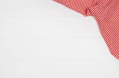 Top view of checkered cloth napkin on white wooden table. Top view of red checkered napkin or tablecloth on white wooden table with visible planks, texture and Royalty Free Stock Images