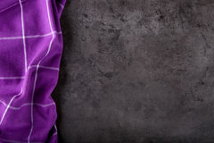 Top view of checkered kitchen purple tablecloth on concrete - stone - marble -  wooden background. Free space for your text Stock Photos