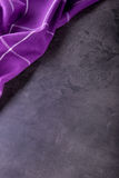 Top view of checkered kitchen purple tablecloth on concrete - stone - marble -  wooden background. Free space for your text Stock Images