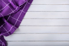 Top view of checkered kitchen purple tablecloth on concrete - stone - marble -  wooden background. Free space for your text Royalty Free Stock Photos