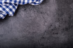 Top view of checkered kitchen tablecloth on granite -  concrete - stone background. Free space for your text or products Stock Photos