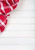 Top view of checkered kitchen towels towels on wooden table Royalty Free Stock Photo