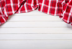 Top view of checkered kitchen towels on wooden table Royalty Free Stock Image