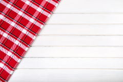 Top view of checkered kitchen towels on wooden table Royalty Free Stock Photo