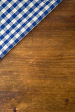 Top view of checkered kitchen towels on wooden table Stock Photography