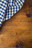 Top view of checkered kitchen towels on wooden table Stock Image