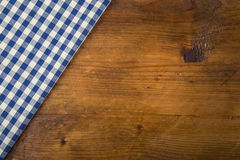 Top view of checkered kitchen towels on wooden table Stock Images