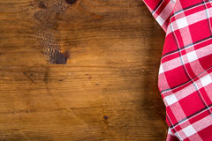 Top view of checkered kitchen towels on wooden table Royalty Free Stock Images