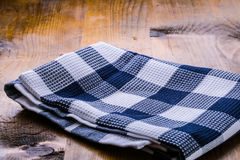 Top view of checkered kitchen towels on wooden table Stock Photo