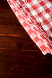 Top view of checkered napkin on wooden table.  Stock Photography