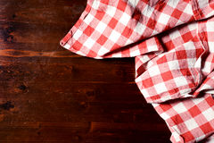 Top view of checkered napkin on wooden table.  Stock Photos