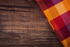 Top view of checkered napkin on wooden table Stock Image