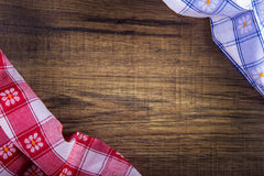 Top view of checkered napkin on wooden table Stock Photography