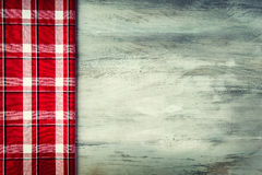 Top view of checkered napkin on wooden table Stock Photos