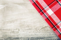 Top view of checkered napkin on wooden table Royalty Free Stock Photography