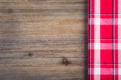 Top view of checkered napkin on wooden table Royalty Free Stock Image