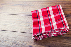 Top view of checkered napkin on wooden table Royalty Free Stock Photo