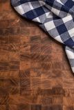 Top  of view checkered tablecloth on empty wooden butcher board Royalty Free Stock Photography