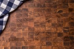 Top  of view checkered tablecloth on empty wooden butcher board Royalty Free Stock Image