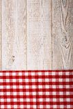 Top view of checkered tablecloth on white wooden table. Stock Photography