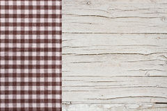 Top view of checkered tablecloth on white wooden table. Stock Photos