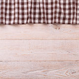 Top view of checkered tablecloth on white wooden Royalty Free Stock Photo