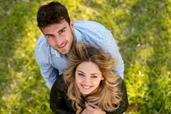Top view. cheerful couple, standing barefoot in the grass looking at camera. Top view. cheerful couple, standing barefoot in the grass looking at camera stock photography