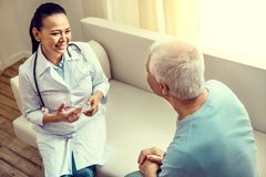 Top view on cheerful doctor and retired patient talking royalty free stock images