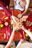 Top view of cheering glasses on Christmas on a blurred background. Family Thanksgiving dinner. Celebrating concept. royalty free stock photos