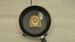 Top view of chef cooking omelet in toast stock footage