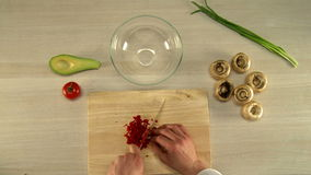 Top view of chef finely cuts red bell pepper stock video footage
