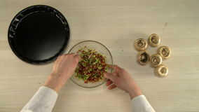 Top view of chef mixes stuffing in glass bowl stock video footage