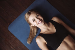 Top view of cherful woman athlete lying on the floor Stock Photo