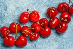 Top view Cherries on blue background stock photos