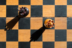 Top view Chess Queens stand on chessboard Royalty Free Stock Photography