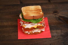 Top view chicken club sandwich. On red napkin stock image