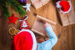 Child writing letter to Santa Claus for Christmas. Top view of child writing letter to Santa Claus for Christmas Stock Photography