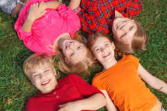 Top view of children lying on the groung Stock Photography
