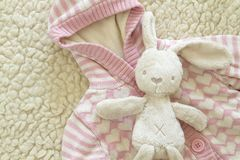 Hildren`s sweater and a toy teddy rabbit Royalty Free Stock Image