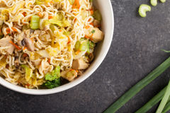 Top view of chinese chicken lo mein with green onions Stock Photo