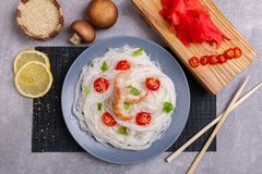 Chinese noodles with sea food on the marble background. Food concept. Royalty Free Stock Photos