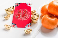 Top view Chinese New year red envelope packet ang pow with g stock images