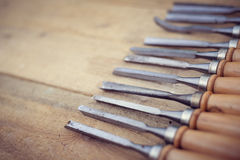Top view of chisel tools set on wooden surface, closeup flat lay Stock Photos