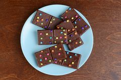 Top view chocolate brownies with candy pieces royalty free stock photo