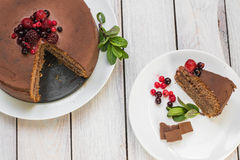 Top view on a Chocolate cake with Ganache and berries fruit and Stock Image