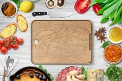 Top view of chopping board and fresh ingredients. For a healthy meal stock image