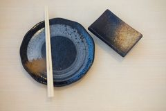 Japanese sushi chopsticks and soy sauce bowl royalty free stock photo